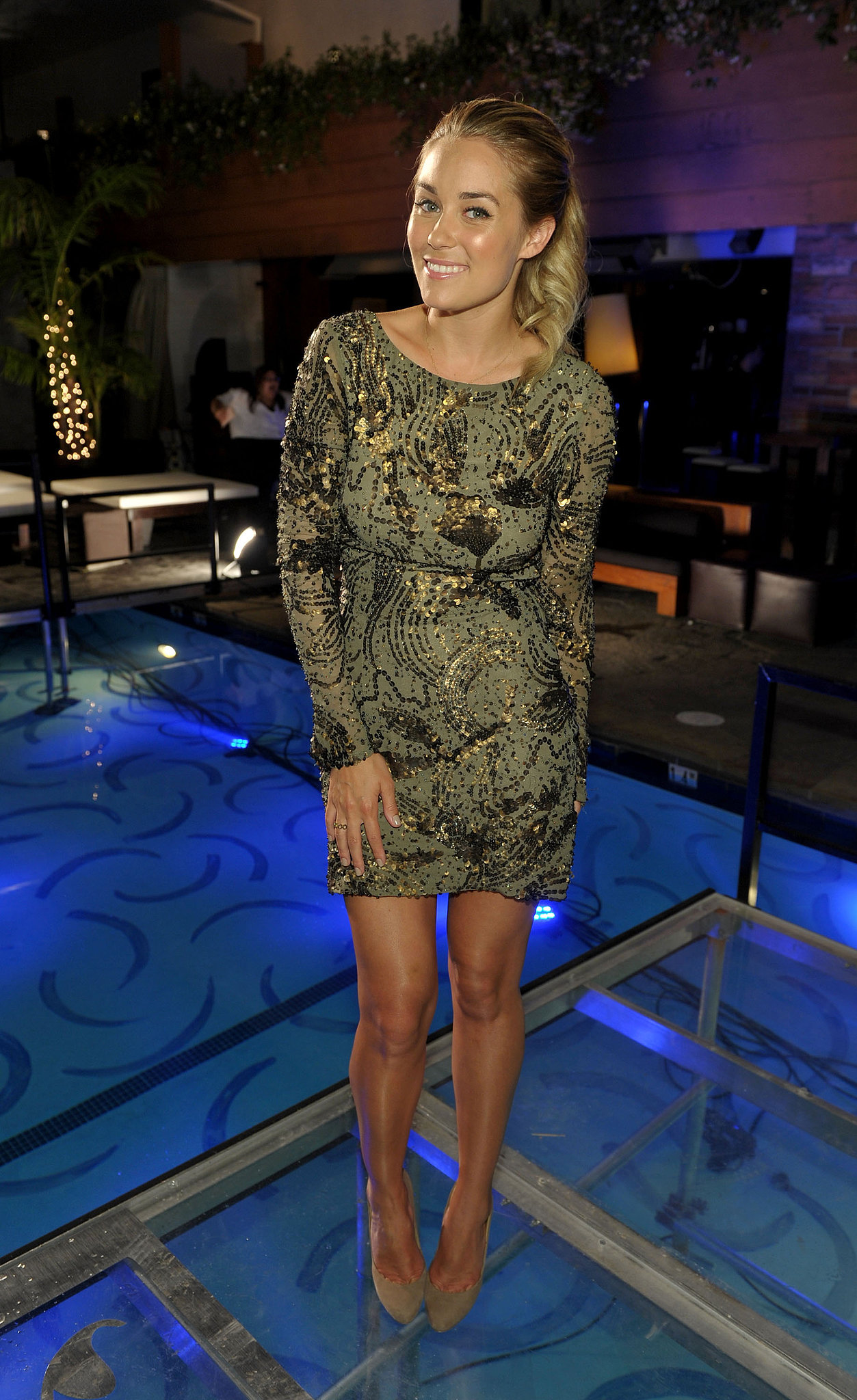 For the finale party of The Hills in 2010, Lauren wore a long-sleeved, printed Mandalay dress with nude pumps from Aldo. Lesson from Lauren: give your printed mini a playful touch with a no-fuss ponytail.