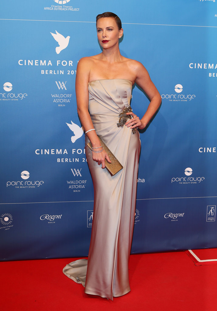 For a more subtle approach, look no further than Charlize Theron's grey satin Gucci strapless gown at the Cinema For Peace Gala in Berlin. Add a jewelled brooch to take the dress from simple to simply dazzling.