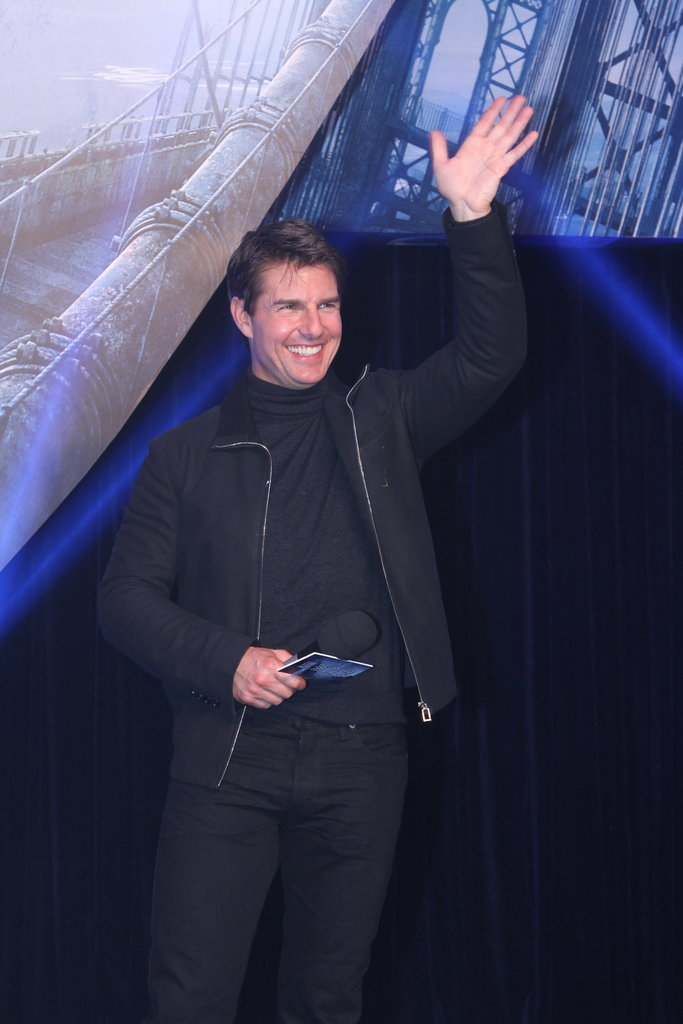 Tom Cruise waved at the Beijing premiere of Oblivion.
