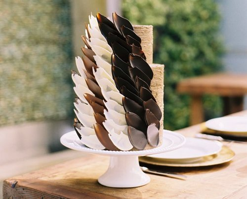 This simple two-tiered cake is given an edgy touch with carefully placed chocolate petals — stunning!  Photo by  Lane Dittoe via Green Wedding Shoes