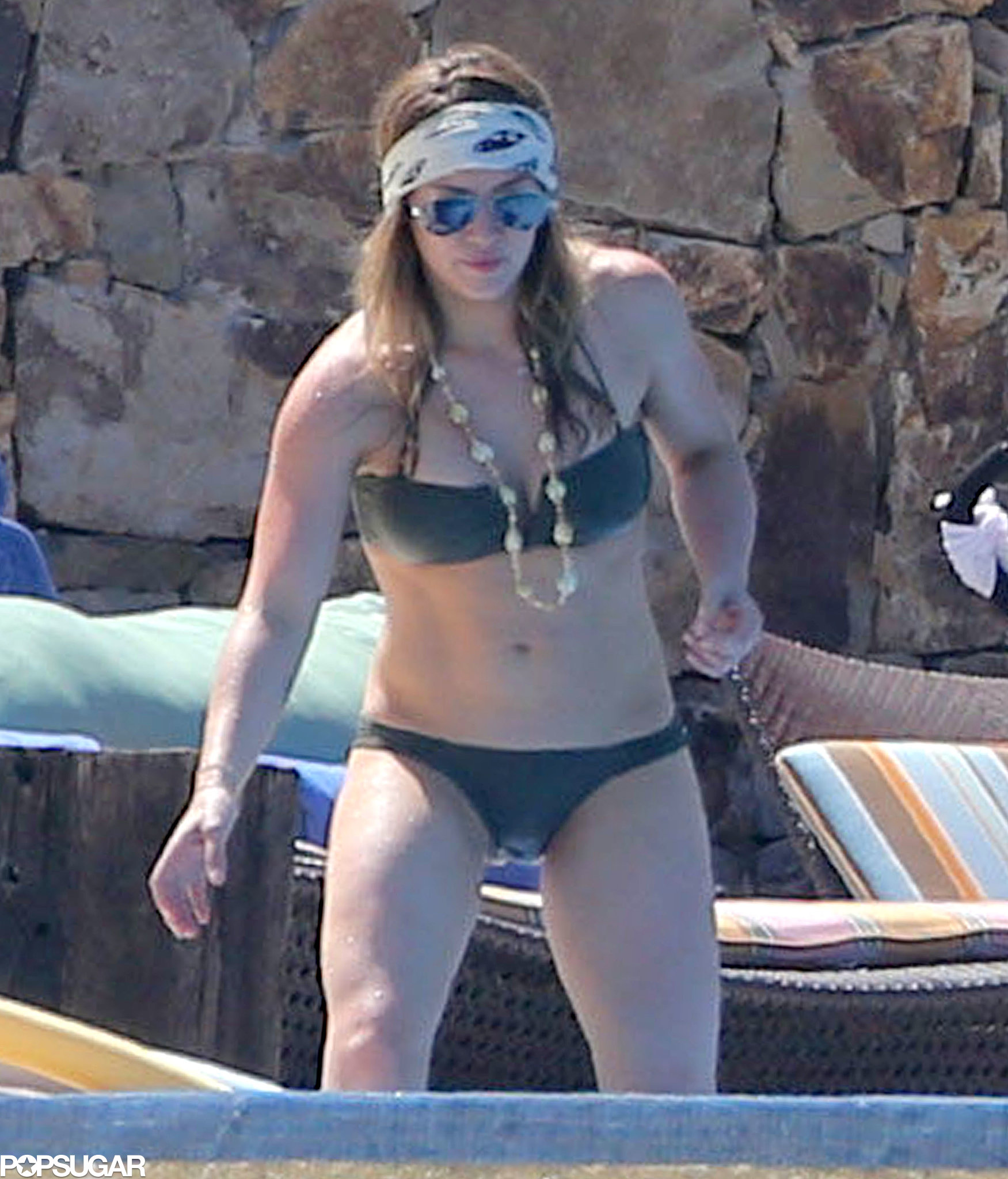 Hilary Duff wore a tiny bikini by the pool.