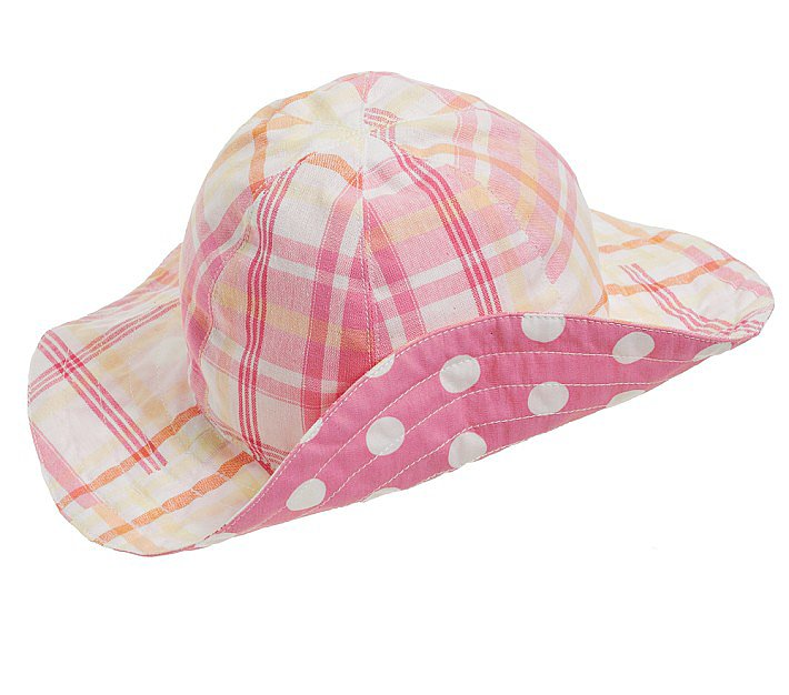 Pottery Barn Kids' reversible sun hat ($15) features bold pink-and-white polka dots on one side and a muted pink-and-orange plaid on the other.