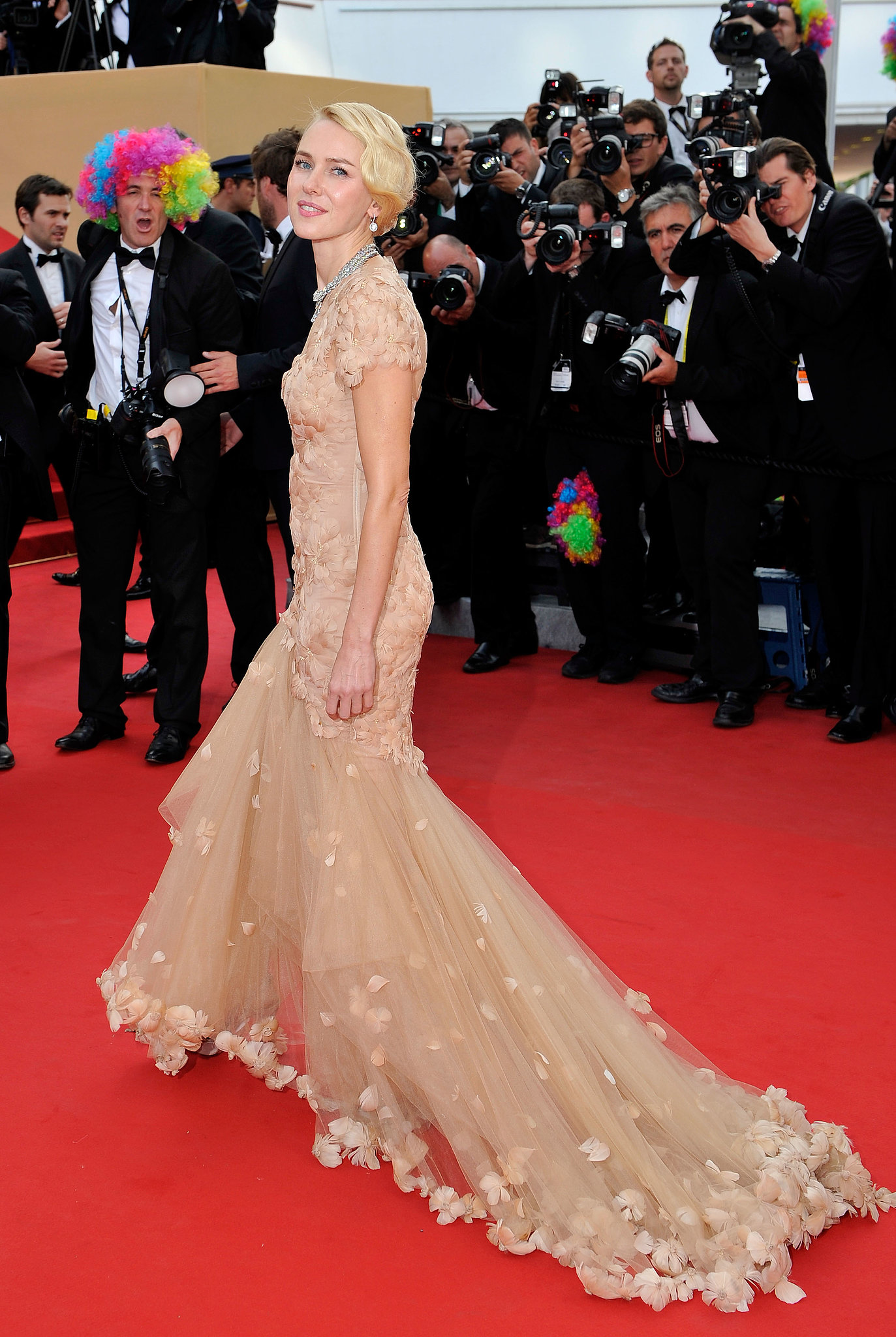 At the Cannes Film Festival in 2012, Naomi Watts walked down the red carpet in a beige frock.