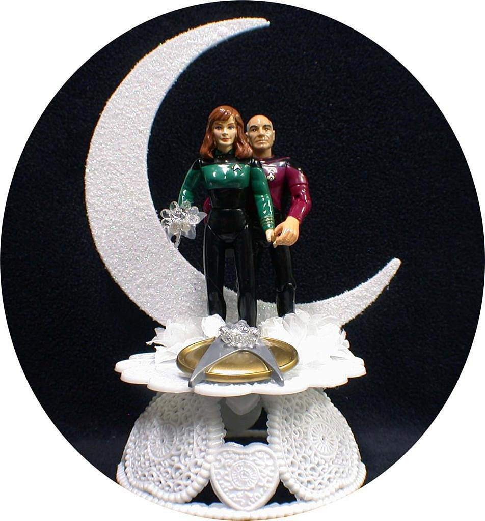 Captain Picard and Dr. Beverly Crusher show their love is out of this world with this white moon-shaped wedding cake topper ($66).