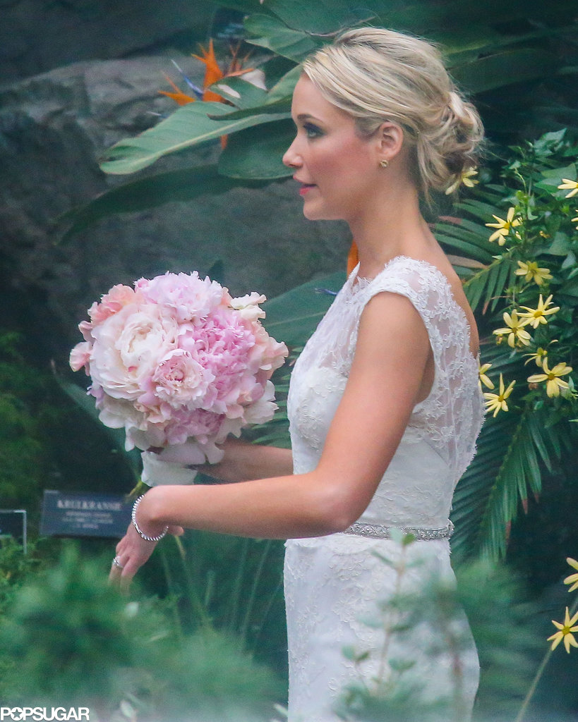 Katrina Bowden carried a pink bouquet down the aisle on her wedding day.