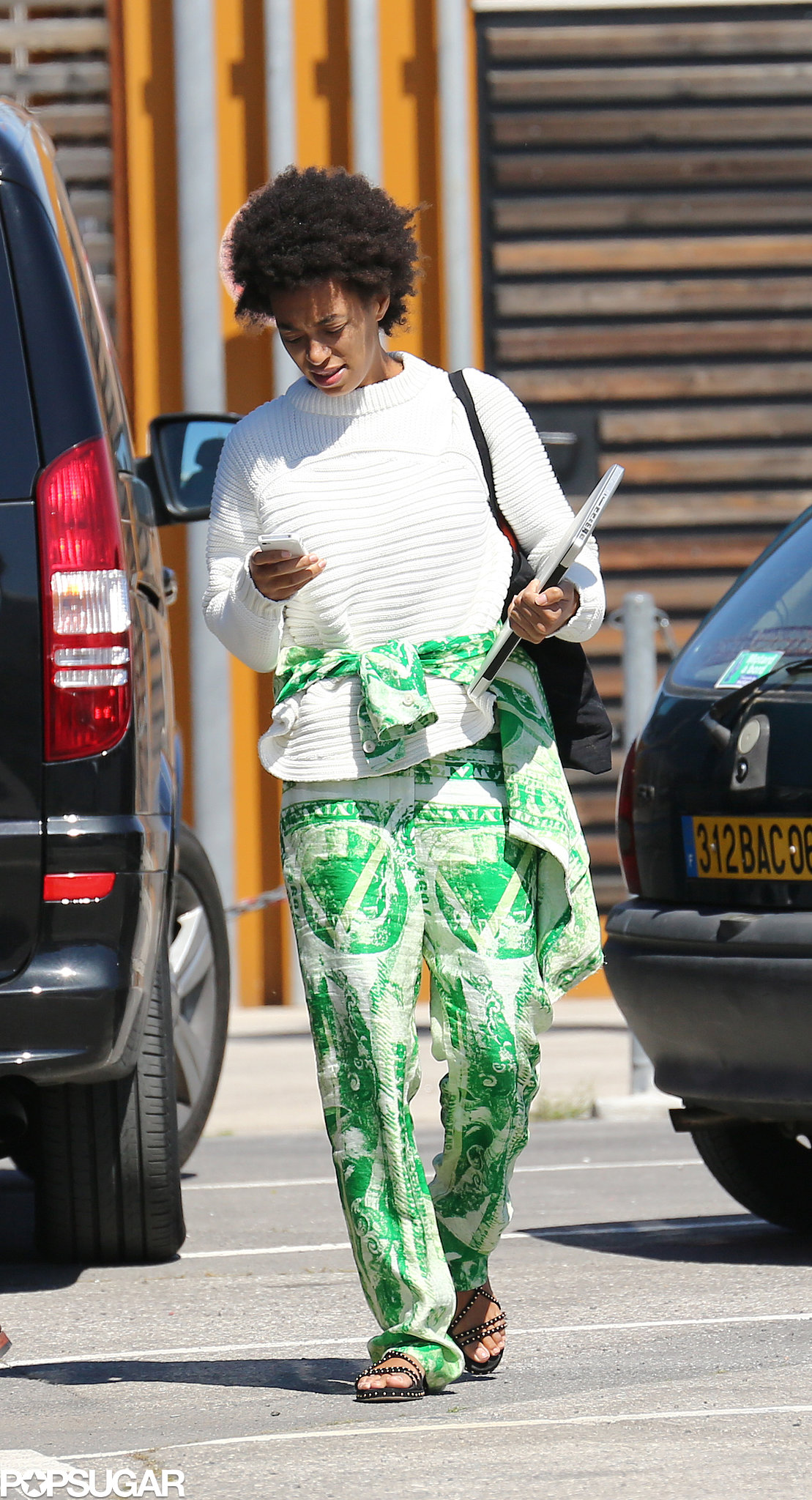 Solange Knowles wore bright green pants for the yacht day.