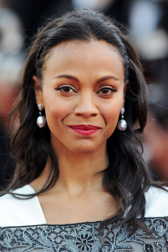 Zoe Saldana was at the Blood Ties premiere with her signature makeup look: winged liner and red lips. She opted for an all-down hairstyle with soft waves.