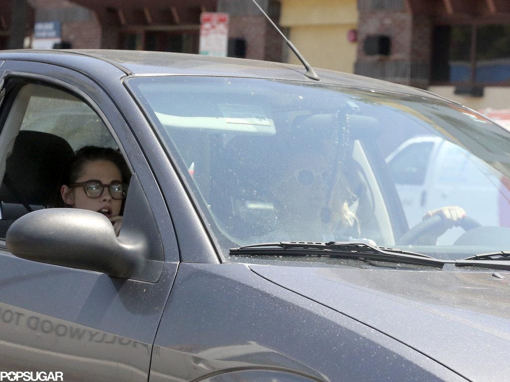 Kristen Stewart rode in the car with her window down.