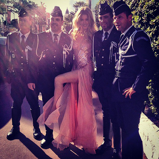 Doutzen Kroes posed with a group of French police officers before hitting the red carpet in Cannes. Source: Instagram user doutzenkroes1