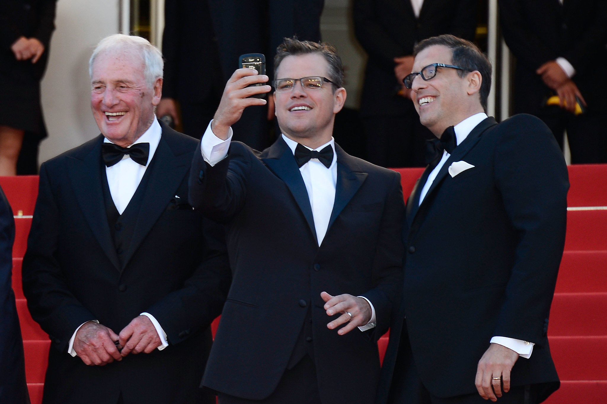 Matt Damon chatted with producer Jerry Weintraub and writer Richard LaGravenese at the Behind the Candelabra premiere on Tuesday.