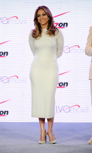Jennifer Lopez showed off her hourglass figure in a white long-sleeved Louise Goldin dress and matching Casadei pumps at a Verizon Wireless event in Las Vegas.