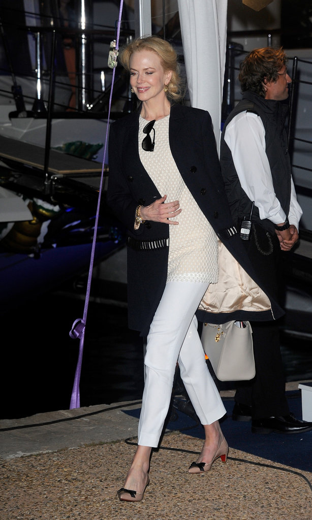 For the Johnnie Walker Yacht Party, it was kitten heels, white slacks, and a blouse and jacket from Chloé's Pre-Fall 2013 collection. Carrying all her extras? A Versace Signature bag.