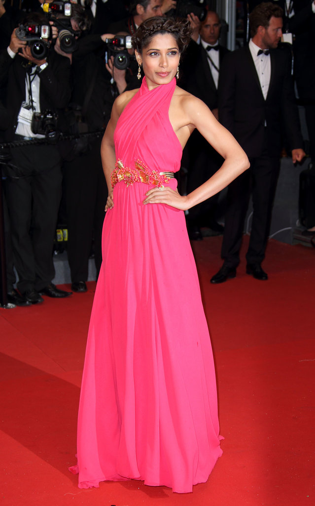 Freida Pinto dazzled the crowd in a pink halter Gucci gown featuring a beautiful belt at the Cannes premiere