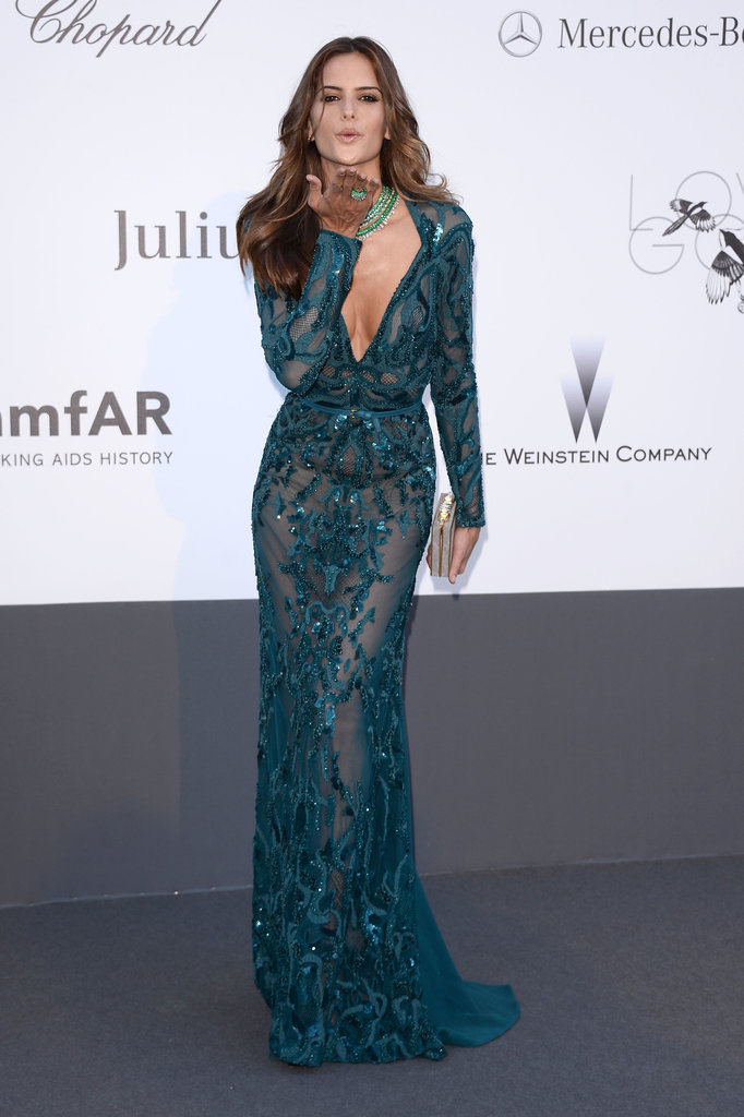 Izabel Goulart sent smooches to the crowd in her teal sheer embellished gown.