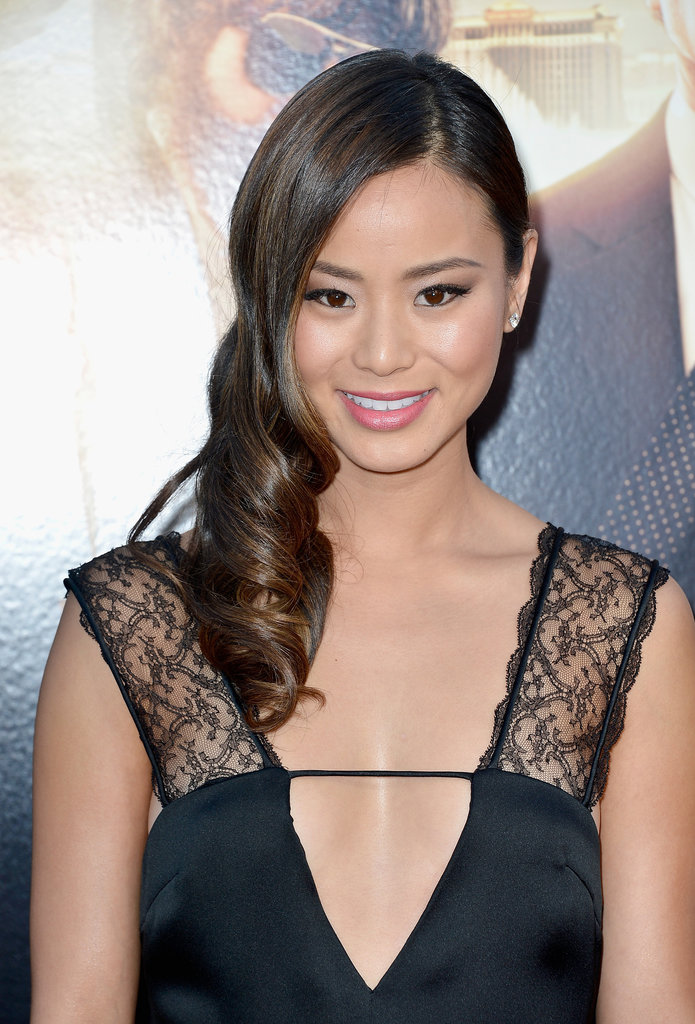 Jamie Chung stunned on the Hangover Part III red carpet with her hair styled in shiny, sideswept waves. Her makeup modernized her Old Hollywood hair with taupe eye shadow and a soft-coral pink lip color.