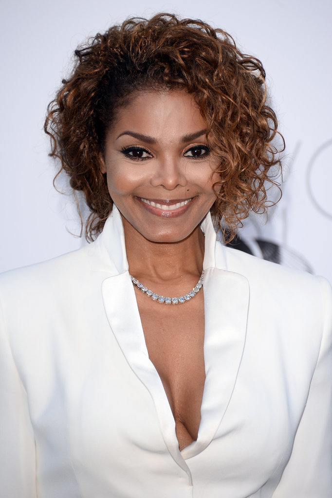 Bronze eye shadow and copper highlights were a winning combination for Janet Jackson.