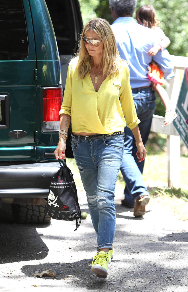 Heidi Klum matched her neon yellow top to her high-top sneakers during a sunny day out in LA.