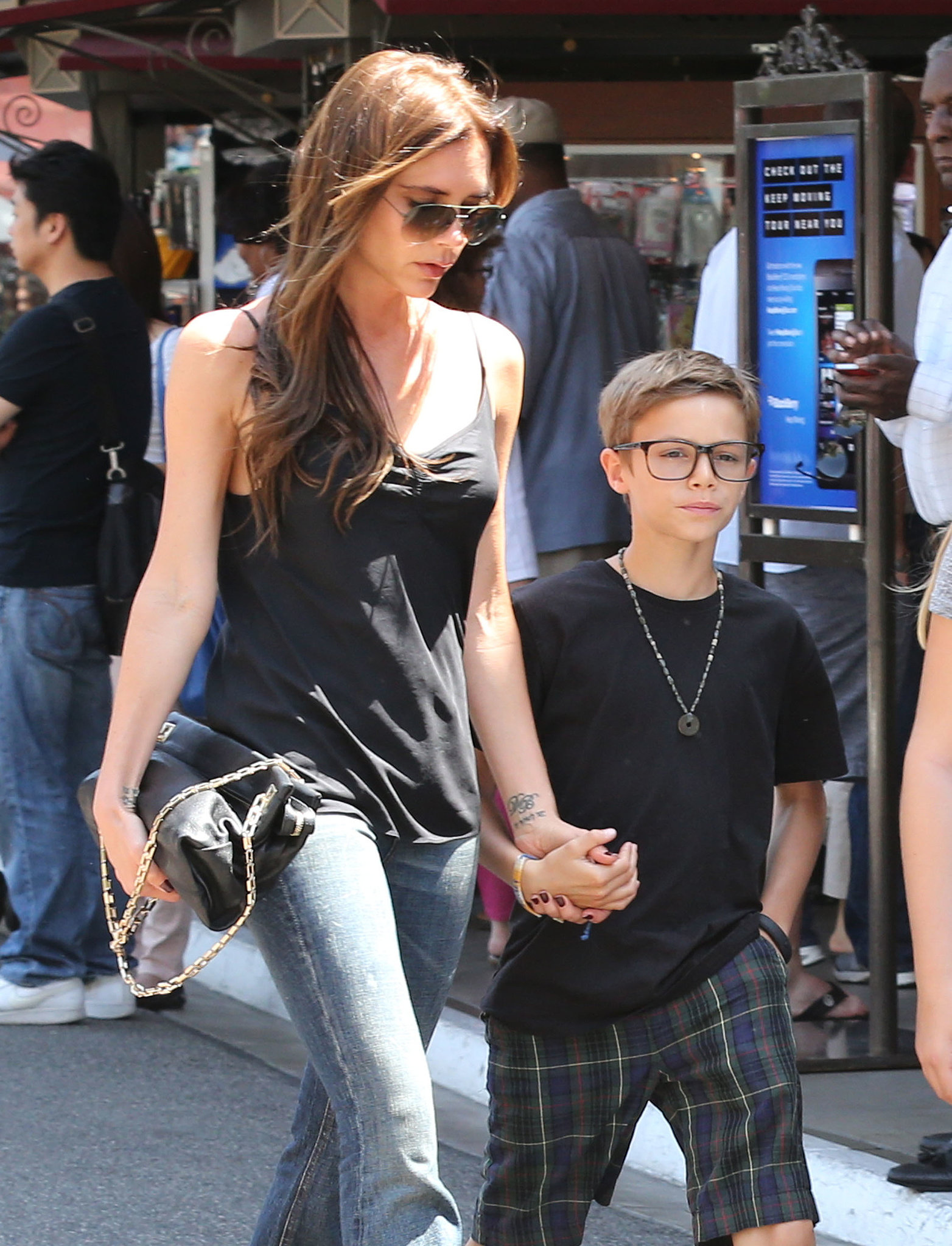 Victoria Beckham held on to Romeo while shopping in LA.