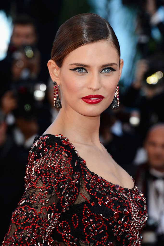 At the La Venus A La Fourrue Premiere, Bianca Balti wore her hair slicked back in a chignon, ultra red lipstick and winged eyeliner.