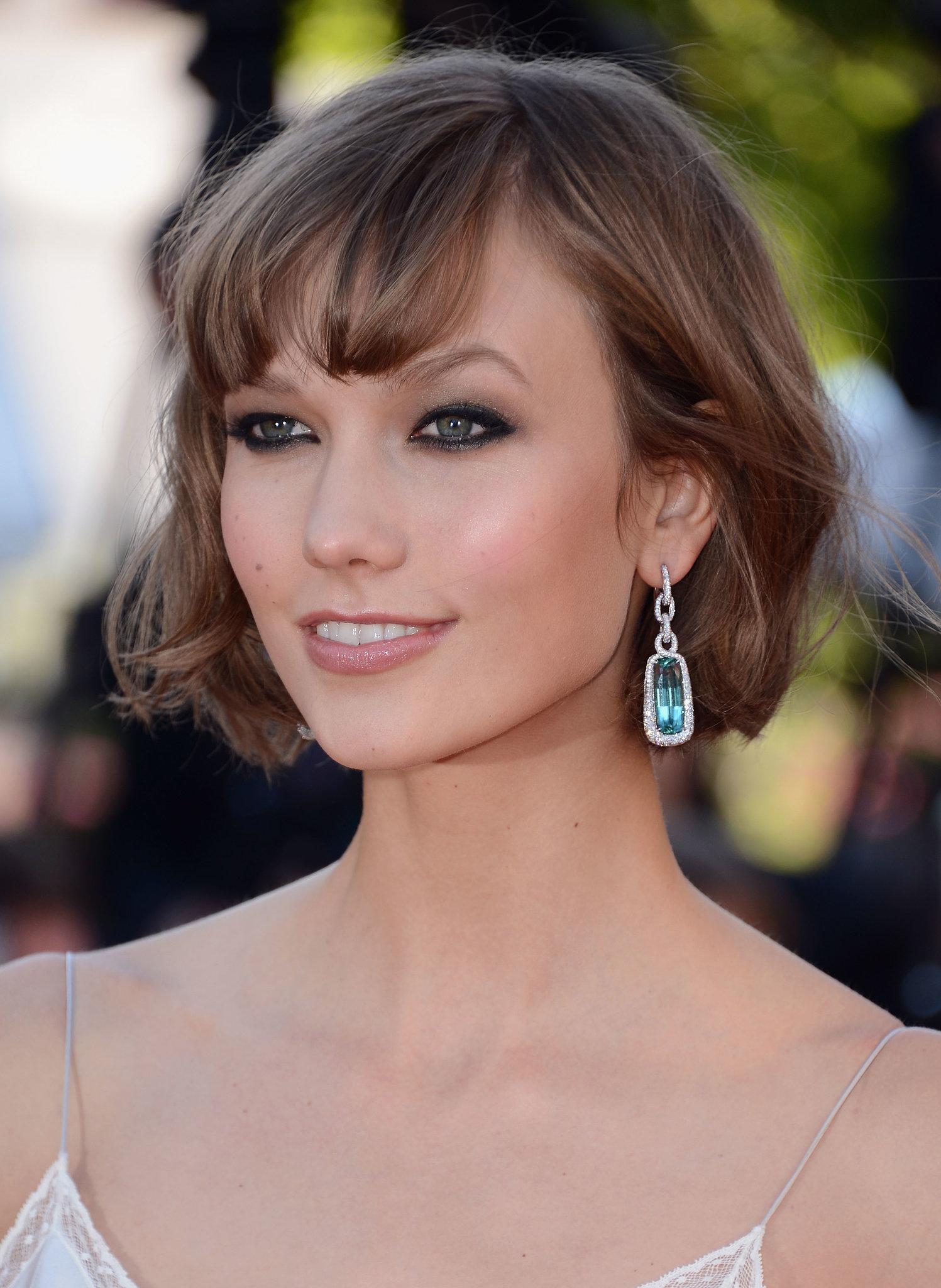 Karlie Kloss wore a pair of aqua-colored gem drop earrings. - Karlie-Kloss-wore-pair-aqua-colored-gem-drop-earrings
