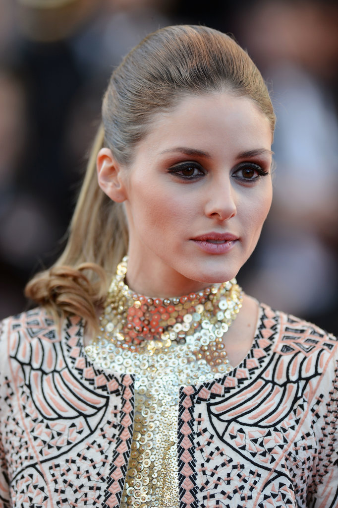 On the Immigrant red carpet at Cannes, Olivia Palermo wore a sleek, dressed-up ponytail paired with a gold-flecked smoky eye.