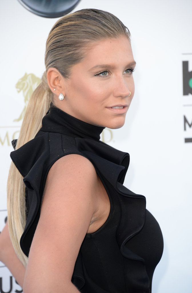 Ke$ha's two-textured ponytail is an easy option postswim. Just add a touch of gel to the roots and flat-iron the ends.