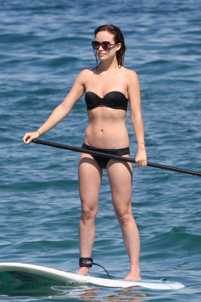 Olivia Wilde went paddle boarding in a black bikini in Hawaii in May 2013.