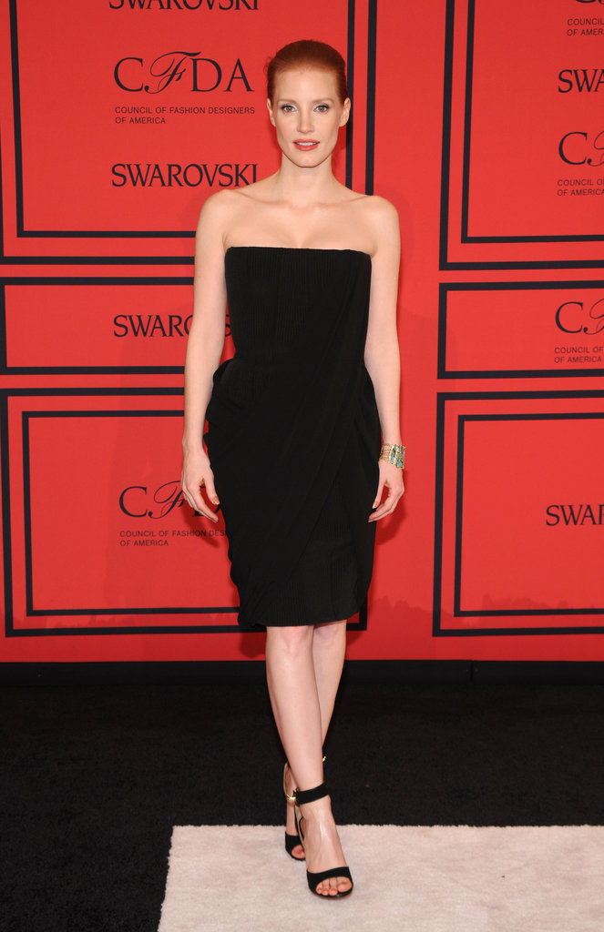 Jessica Chastain managed to make a simple black strapless Givenchy dress look superbly sexy. She finished with ankle-strap sandals and an Irene Neuwirth cuff.