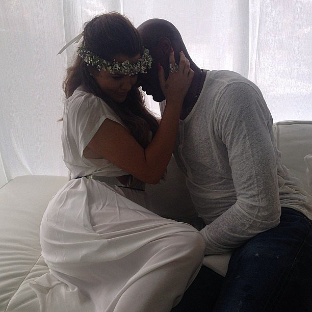 Khloé Kardashian shared a romantic moment with her husband, Lamar Odom, at Kim Kardashian's baby shower.  Source: Instagram user KhloeKardashian
