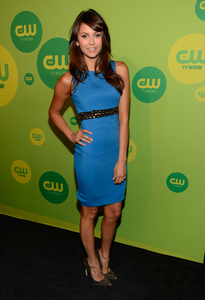 For the 2013 Upfronts, Dobrev struck a pose in a fitted cobalt Versace sheath, featuring tough chain detailing, and metallic Rupert Sanderson pumps.
