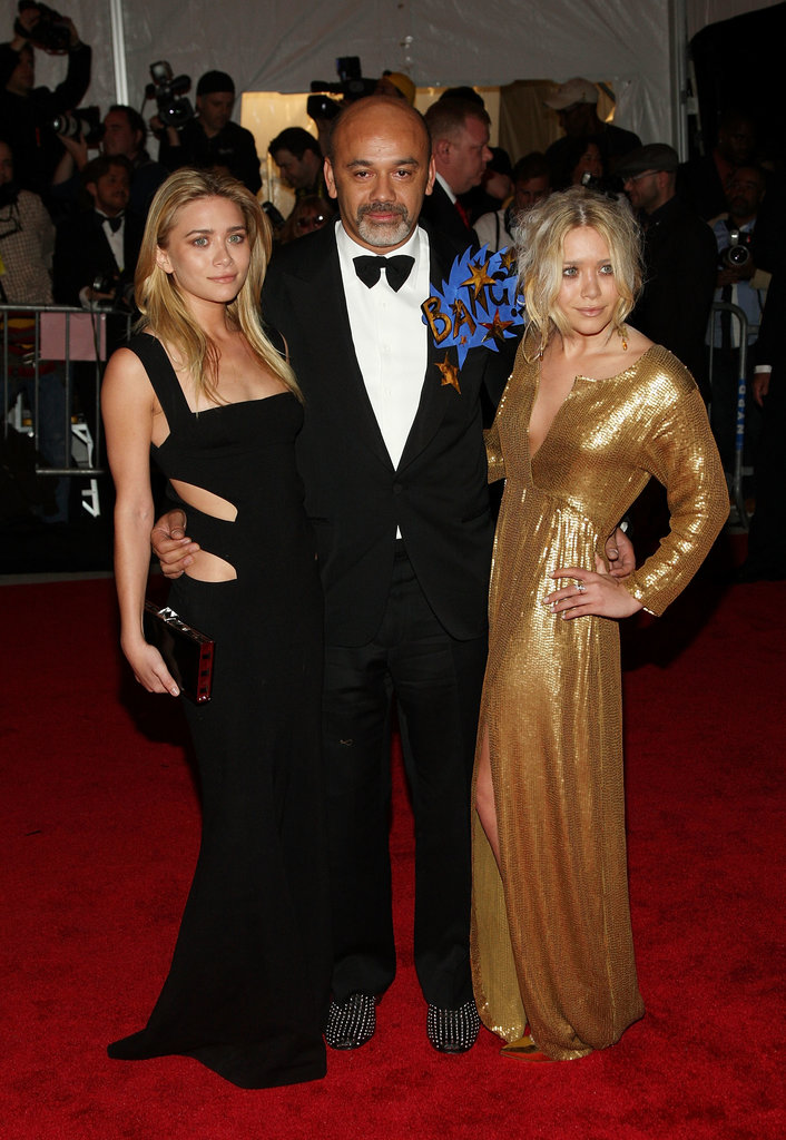 Twinning combo: The duo looked absolutely stunning in peekaboo Diane von Furstenberg gowns while posing next to Christian Louboutin on the 2008 Met Gala red carpet.  Ashley flaunted her fit figure in a black cutout gown. Mary-Kate glowed in a gold sequined number, complete with plunging neckline and thigh-high slit.