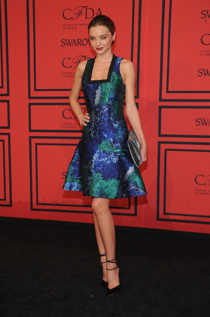 Miranda Kerr's blue eyes popped thanks to her vivid blue and green fit-and-flare printed Proenza Schouler dress, which she completed with a silver clutch and black Stuart Weitzman pumps.