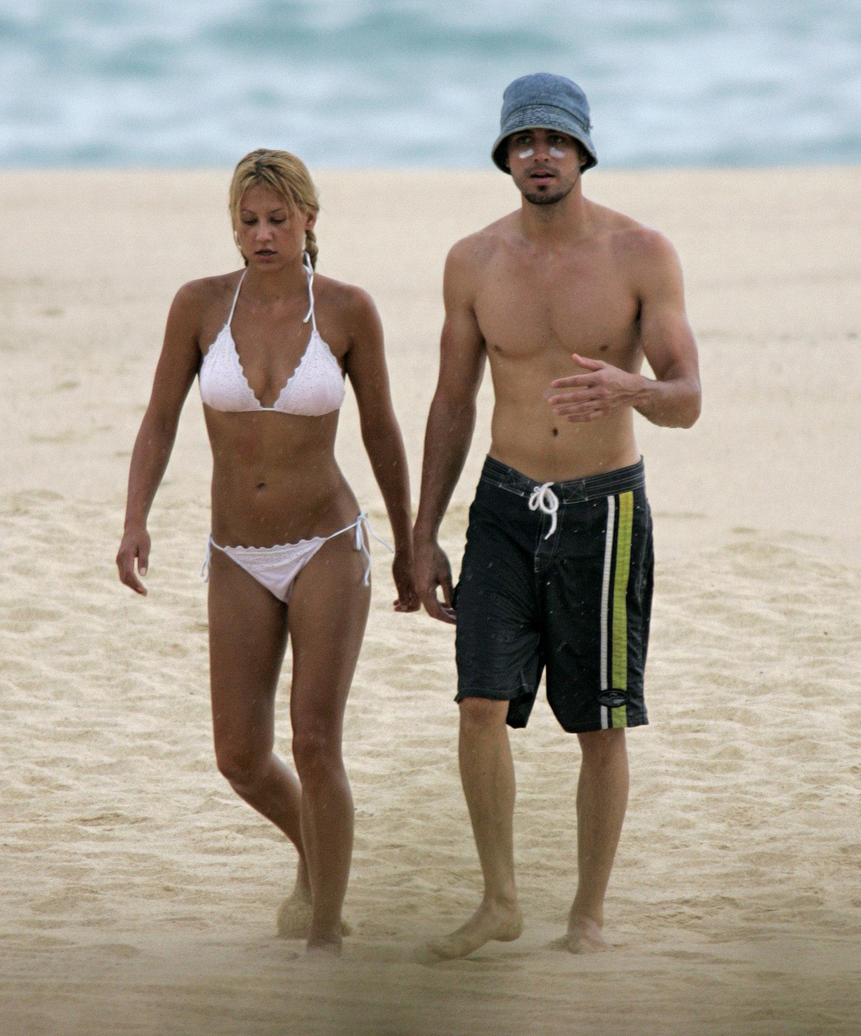 Anna Kournikova wore a white bikini to hit the beach in Mexico with Enrique Iglesias in October 2004.
