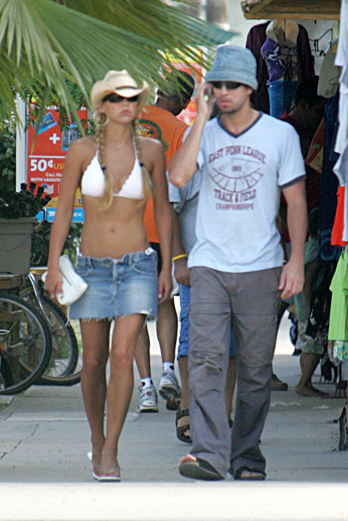 Anna Kournikova accessorized her bikini with a hat and short skirt in Mexico with Enrique in October 2004.
