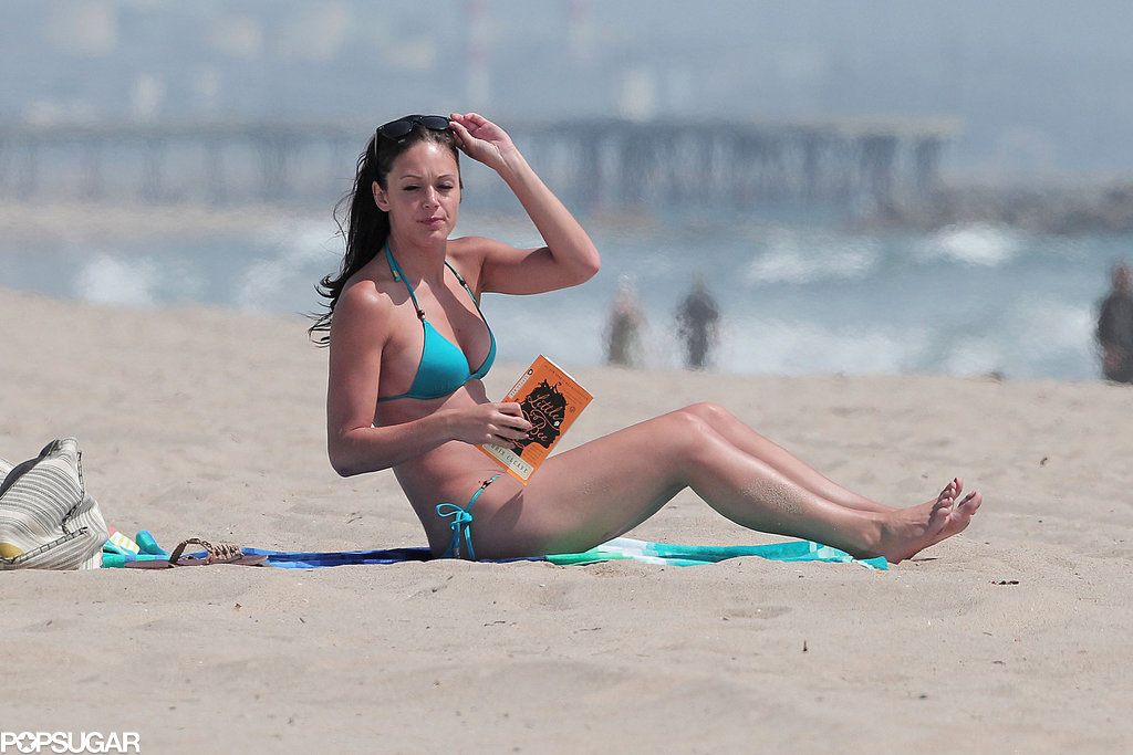 Desiree Hartsock read Little Bee during a beach day in LA.