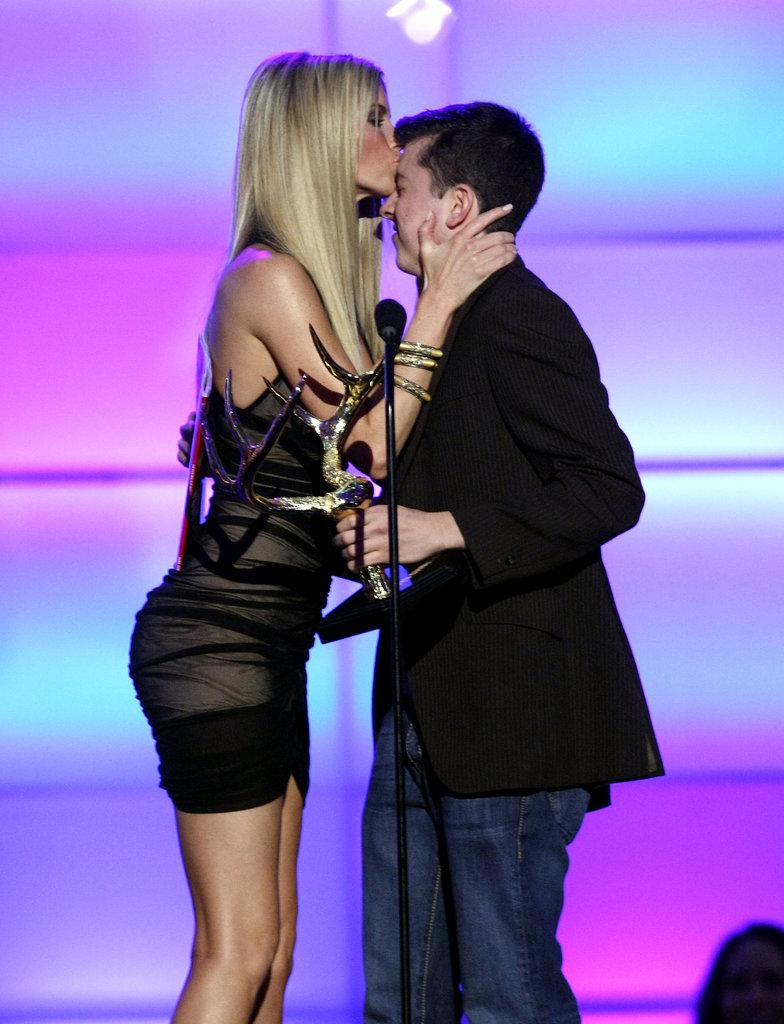 Christopher Mintz-Plasse got a kiss from Marisa Miller in 2008.
