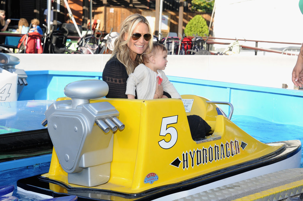 Molly Sims and Brooks Stuber enjoyed the rides at the 2013 Baby Buggy Bedtime Bash.
