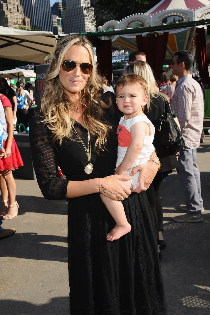 Molly Sims and Brooks Stuber enjoyed the carnival at the 2013 Baby Buggy Bedtime Bash.