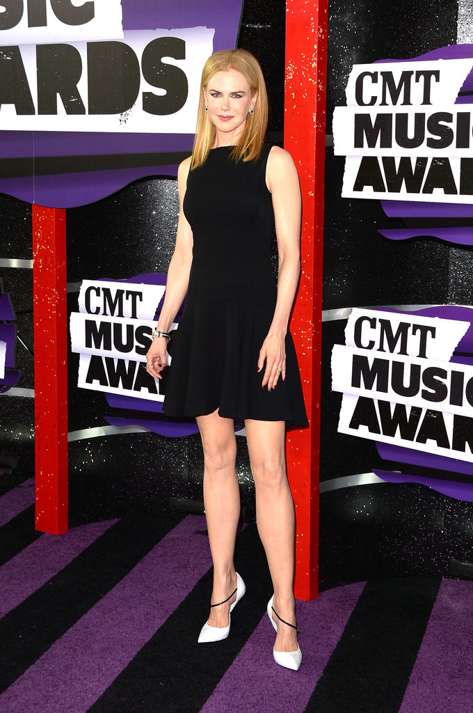 Nicole Kidman wore head-to-toe Dior for the 2013 CMT Music Awards. She paired a little black dress with white pumps accented with a sleek black strap.