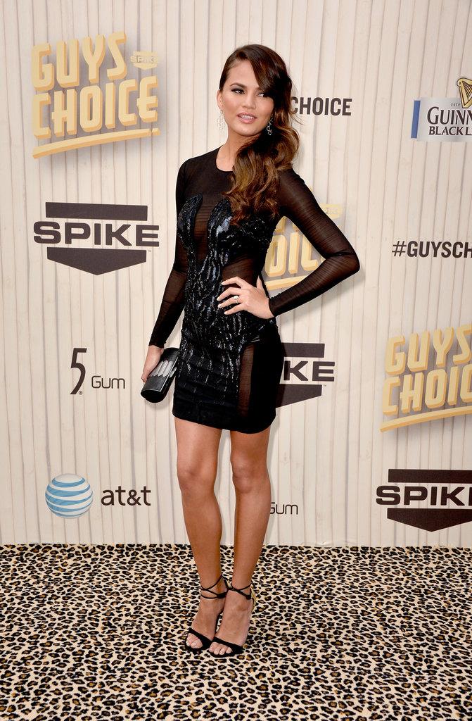 Chrissy Teigen wore a short black dress on the red carpet.