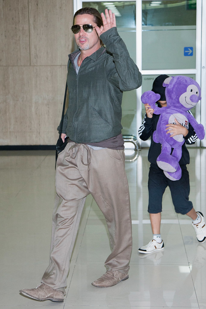 Brad Pitt was joined by son Pax when they landed in South Korea.