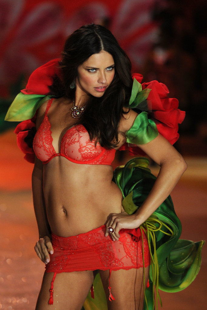 Adriana Lima showed skin in bright red lingerie for the November 2012 Victoria's Secret Fashion Show in NYC.