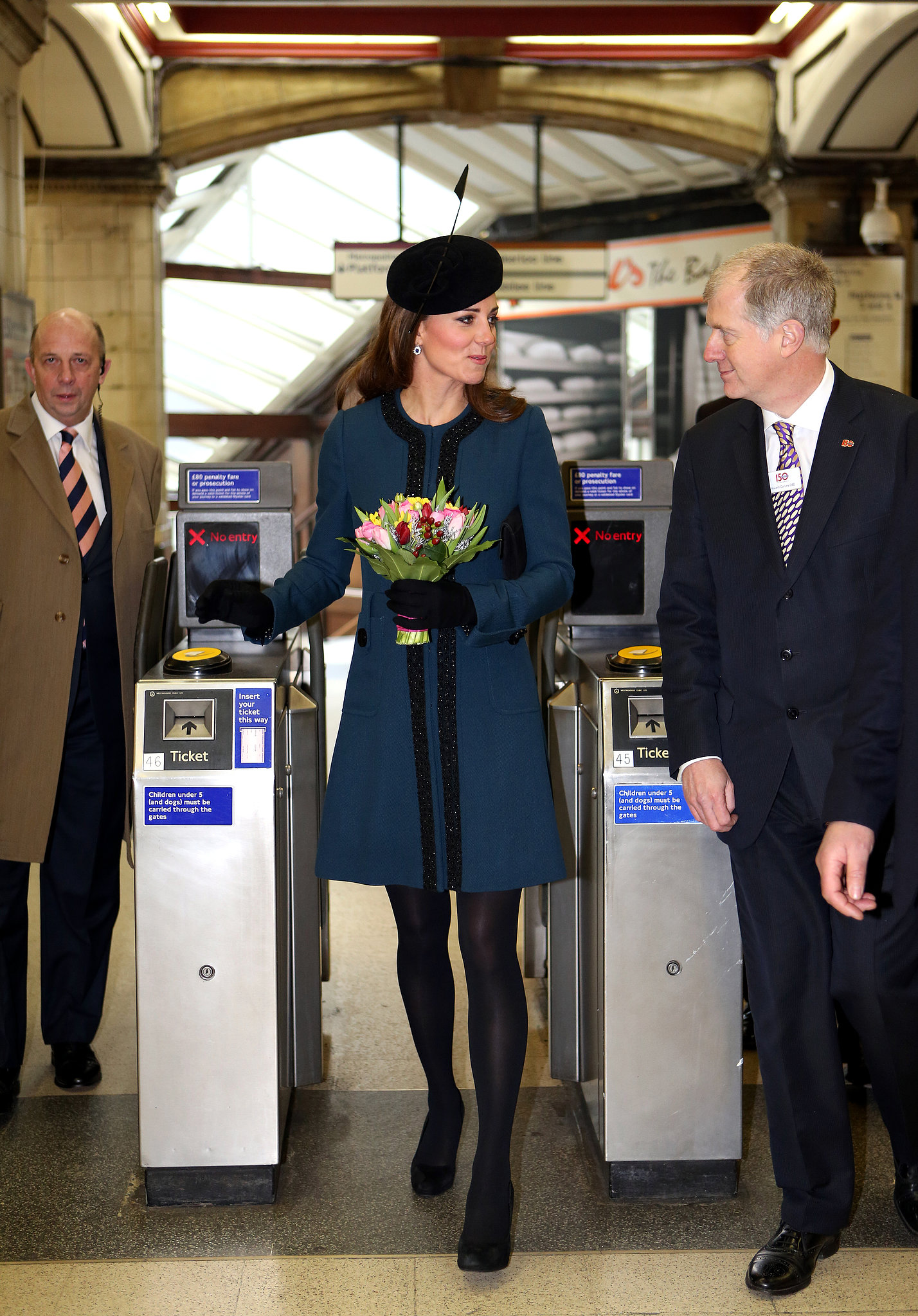 Kate toured a subway station in London with Queen Elizabeth II in March 2013.