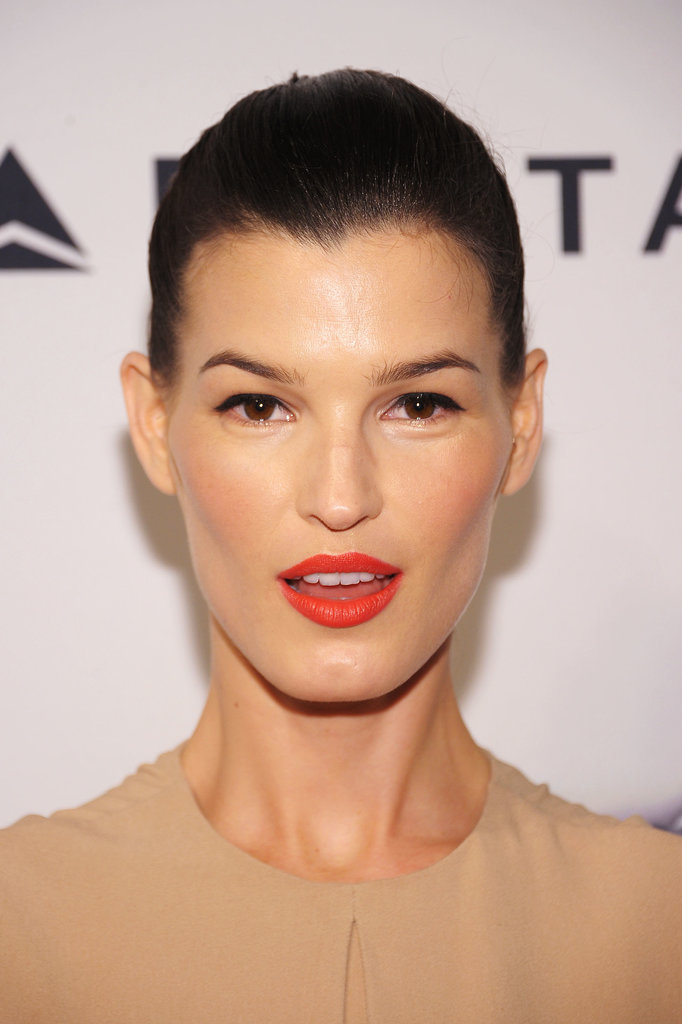 Hanneli Mustaparta's look, with tangerine lips and apricot cheeks, was gorgeous enough . . .