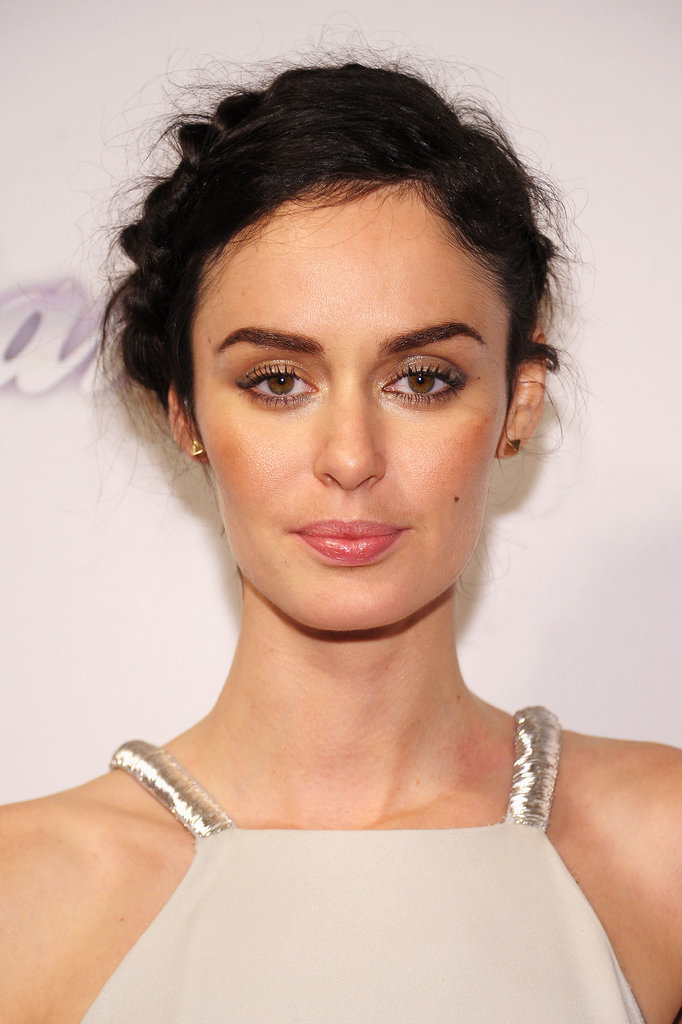 Nicole Trunfio paired a textured updo with bold brows and metallic eye shadow.