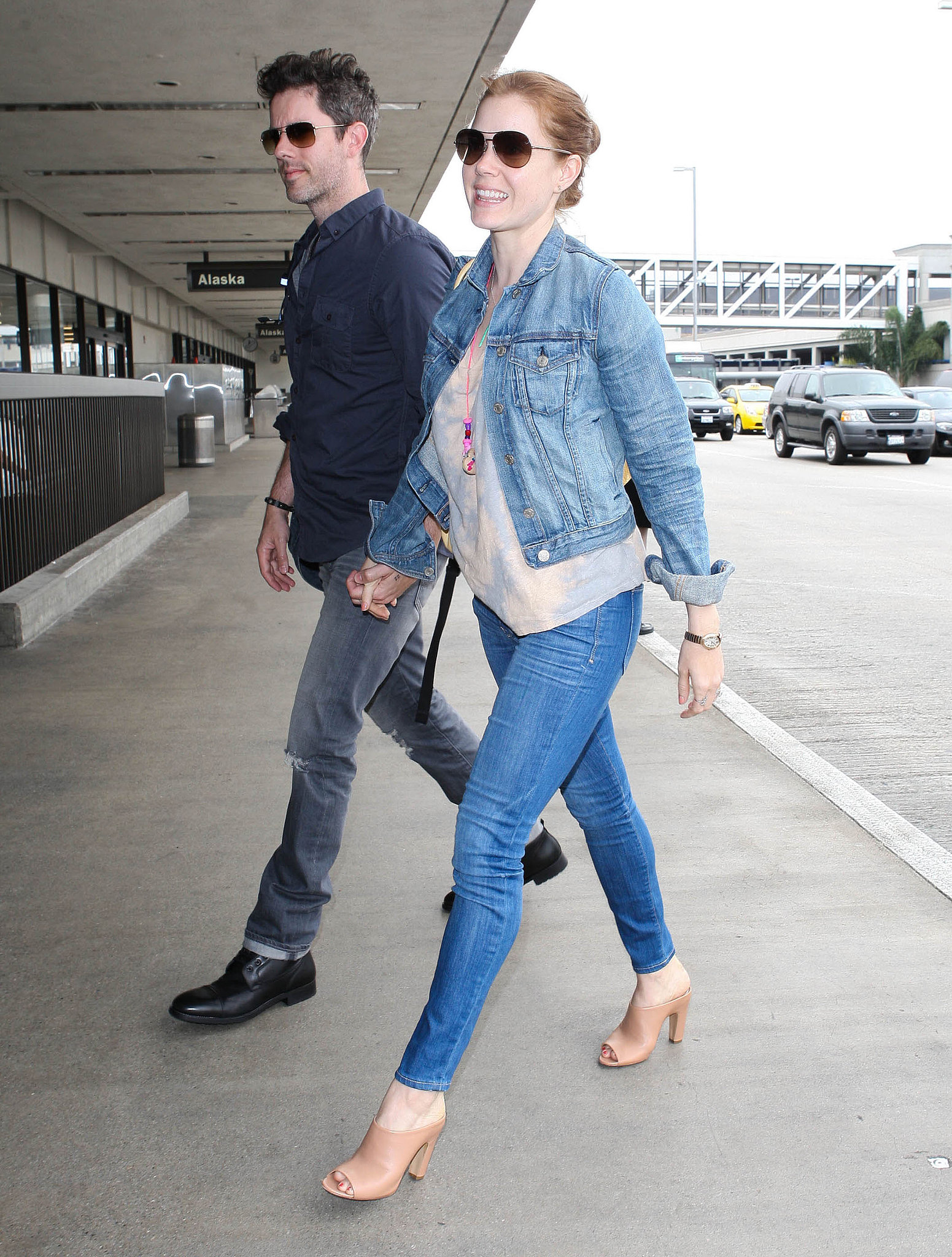 Amy Adams got ready to take off in double the denim. She started with skinny jeans, then added a lighter denim jacket for further cool.