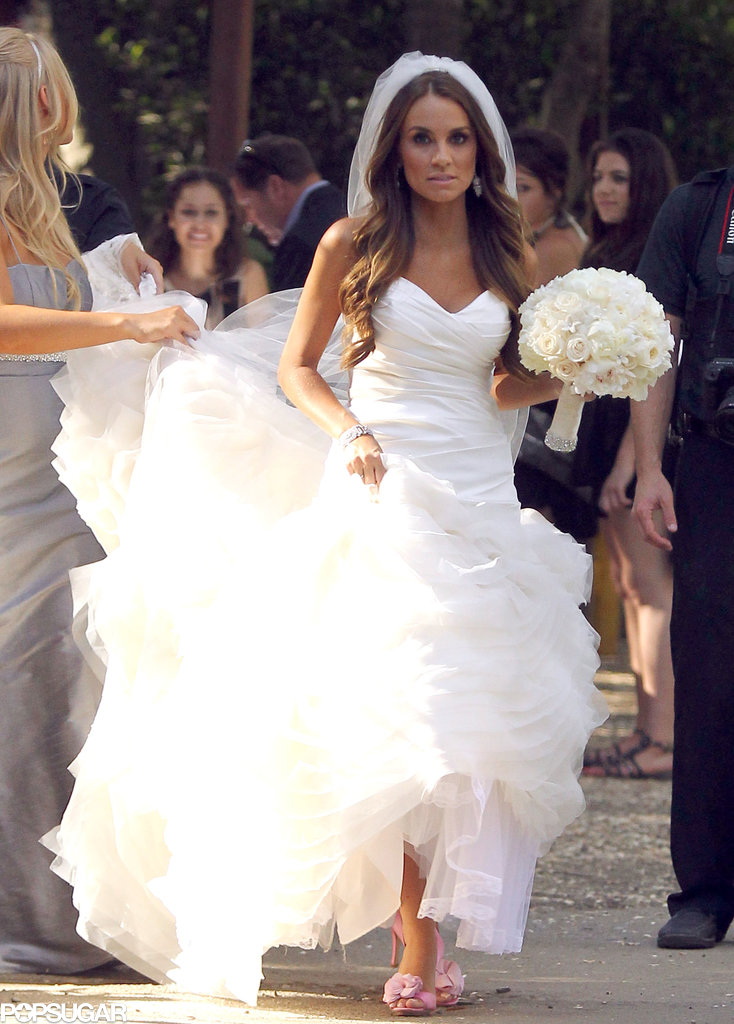 angela stacy carried a white bouquet