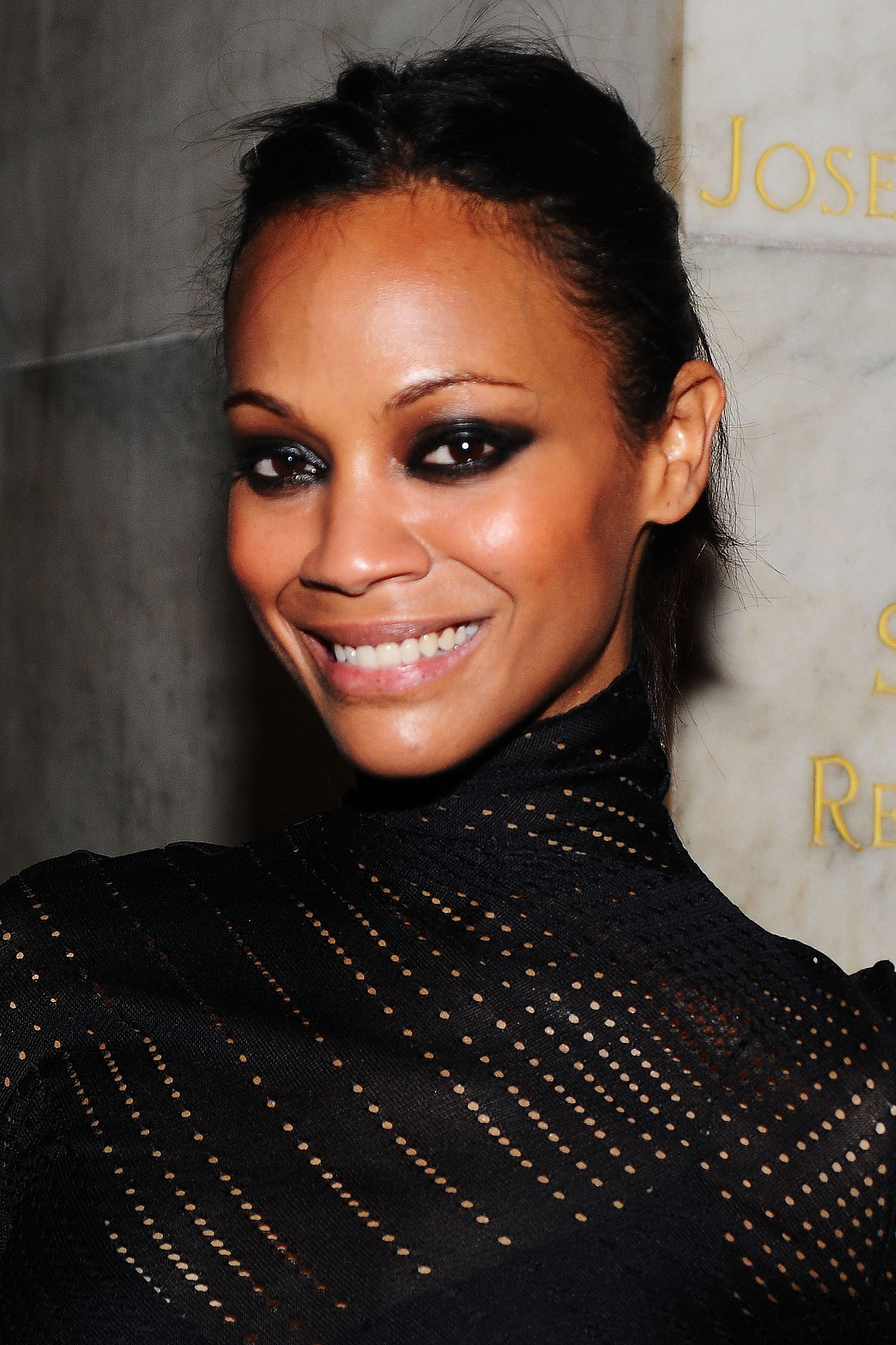 For the 2010 amfAR New York Inspiration Gala, Zoe went for a dramatic look with her hair pulled back and black eye shadow in a cat-eye shape.