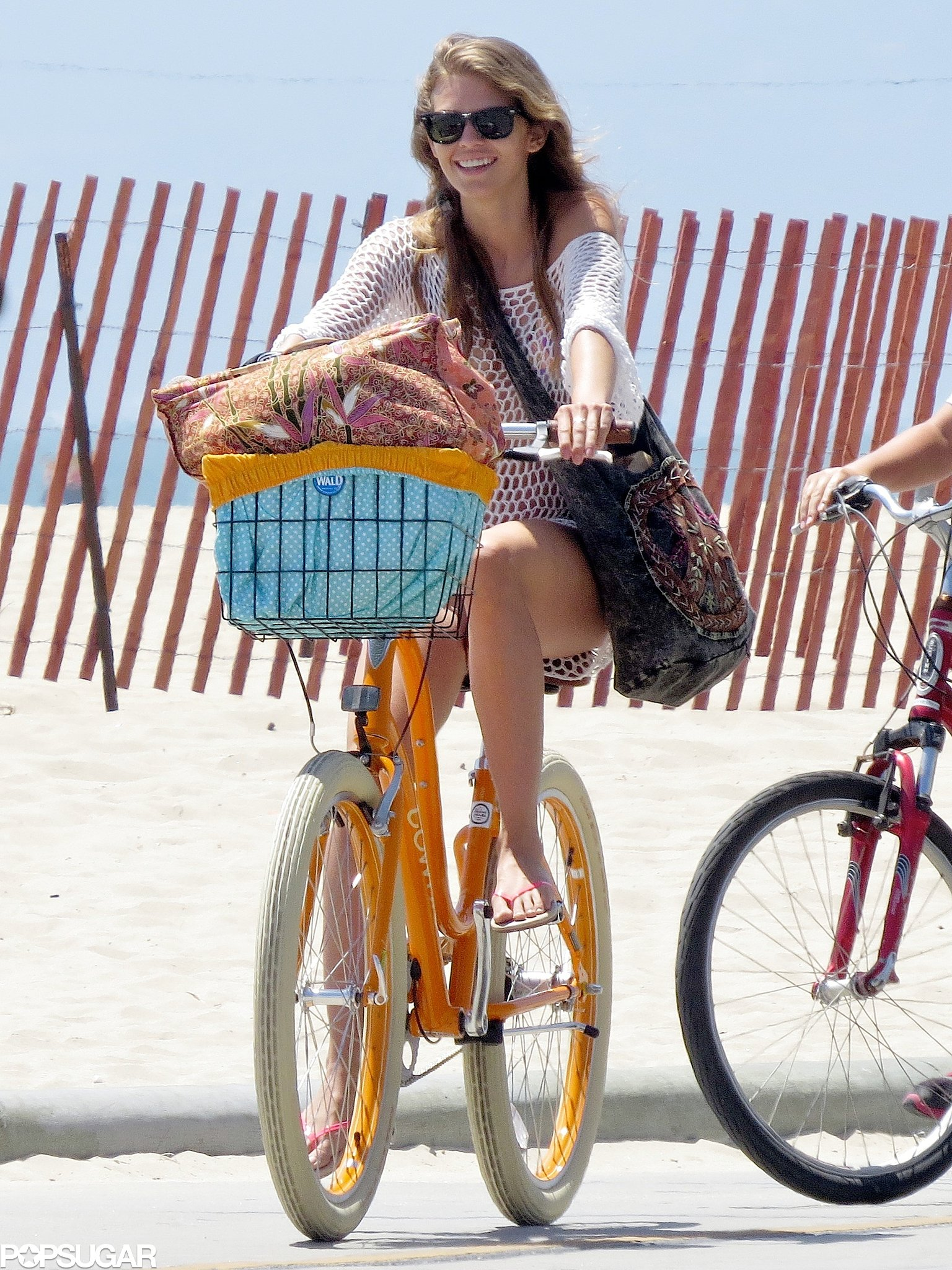 AnnaLynne McCord hit the beach in LA on her yellow bicycle back in June.