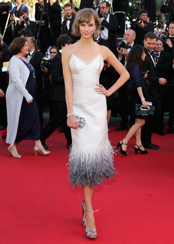 Karlie Kloss gave a chic nod to the '20s in her white feathery dress and beaded clutch at the Cannes Film Festival.